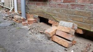 Wall of a Victorian home exposed to gain access due to internal damp problems