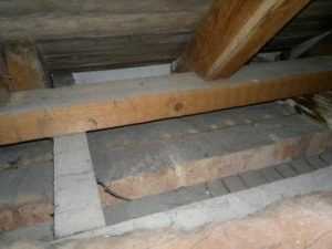 Damp specialist Dorchester apply a woodworm treatment to this property's loft in Dorchester