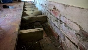 Rising damp caused due to the dpc being installed to high and the old floor is to low