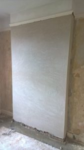 Penetrating damp specialist has to repasted using breathable plaster
