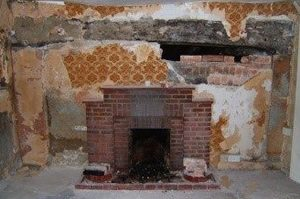 Rising damp in solid wall property affected by damp around the fireplace