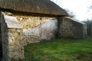Stone cottage affected by penetrating damp due to raised ground levels on solid outer wall