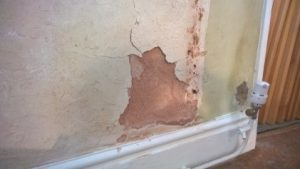 Damp information about salts in buildings ruining gypsum plaster